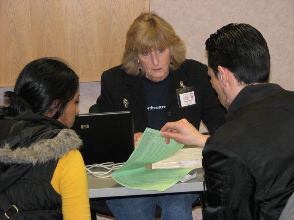 Volunteer from Northwestern Mutual helps residents with their taxes during the most recent VITA tax season.