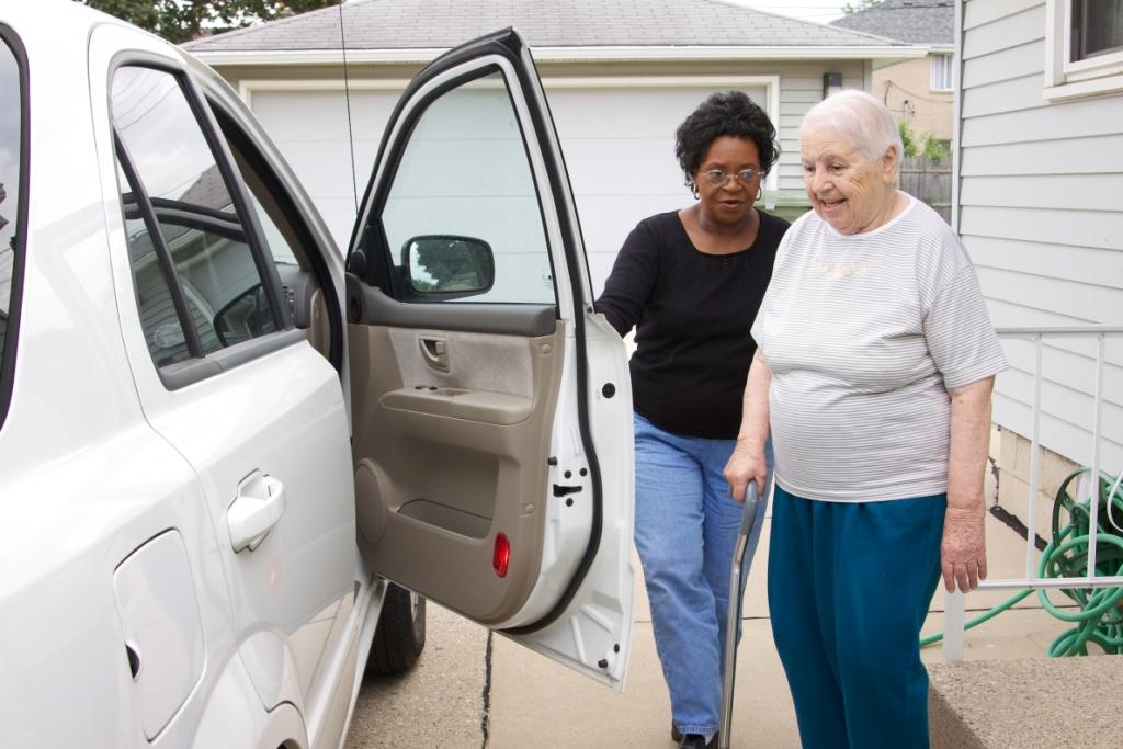 A volunteer for SDC's Senior Companion Program helps her companion with an appointment.