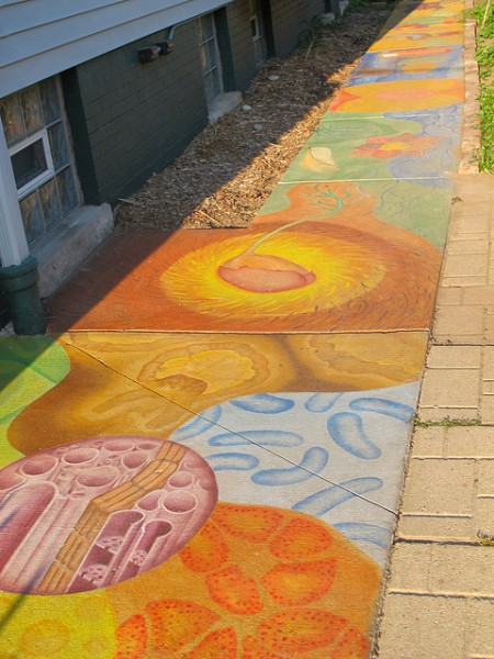 Sidewalk art designed by young artists leads from the front to the back of Walnut Way on north 17th Street. (Photo by Shakara Robinson)