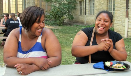 Mount Mary University freshmen Kadesia Hill (left) and Darneisha Virginia share a funny moment at the welcome picnic in the courtyard outside their dorm, Caroline Hall. (Photo by Andrea Waxman)