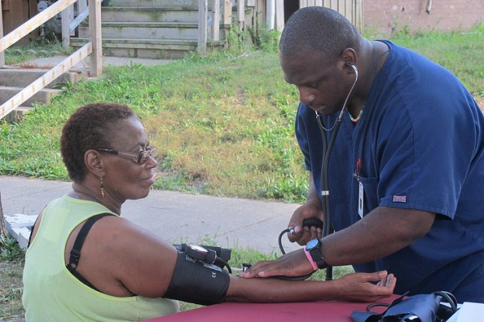 A resident receives a free blood pressure screening at a recent Metcalfe Park health and wellness event. (Photo by Shakara Robinson)