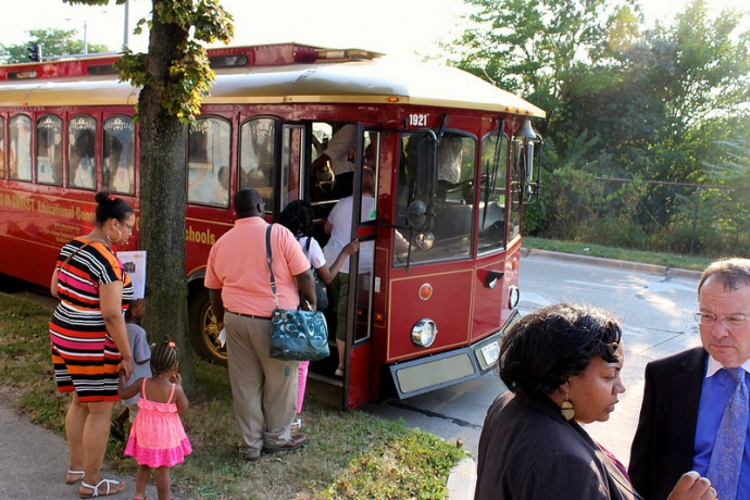 Participants board the trolley, as Alderwoman Milele Coggs and Rocky Marcoux, commissioner of the Milwaukee Department of City Development talk over the tour. (Photo by Karen Slattery)