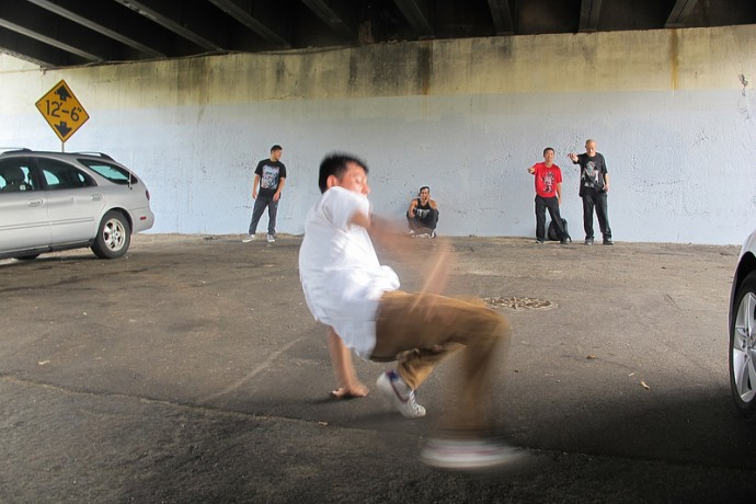 """""""B-Boy Archie"""" preps for the break dancing contest under the 35th Street viaduct. (Photo by Edgar Mendez)"""