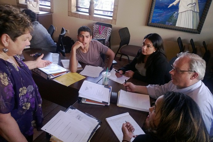Latino Nonprofit Leadership Program participants work together to solve programs during a class. (Photo courtesy of the Latino Nonprofit Leadership Program)