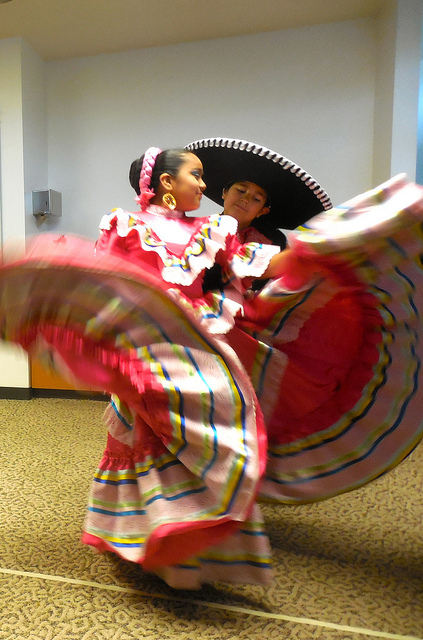 Members of the Dance Academy of Mexico perform a traditional dance from the state of Jalisco, Mexico. (Photo by Maria Corpus)