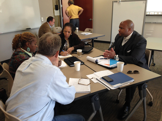 (from front left) Jeff Goebout (back to camera) of Pho-Tronics, Daphne Jones of Malone's Fine Sausage, Inc., Annette Tipton of Able Access Transportation LLC and Ugo Nwagbaraocha of Diamond Discs International. (Photo courtesy of Greater Milwaukee Committee):