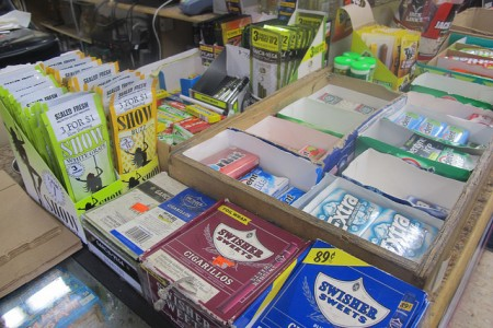 Flavored tobacco products can be found on the counter next to candy in central city stores. (Photo by Edgar Mendez)