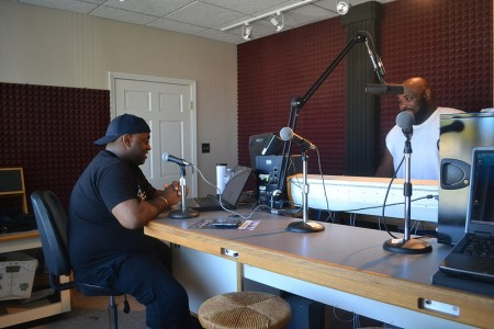 Sherwin Hughes (left) is on the air at WNOV. (Photo by Tom Momberg)