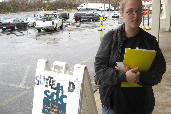 Kristina Smith, 27, arrives at the Social Development Commission office on Chase Avenue to apply for the Wisconsin Home Energy Assistance Program. (Photo by Brendan O'Brien)