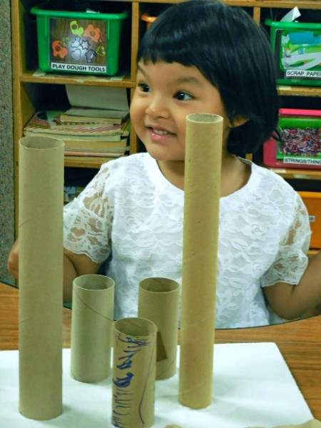 Win Yin Khoing, 3, has attended the preschool for a year and is seen as a class leader by her peers and her teacher, Bao Her. (Photo by Maria Corpus)