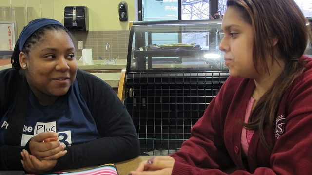 Darneisha Virginia (left) and Nury Plascencia catch up in the café at Mount Mary University's Haggerty Library. (Photo by Andrea Waxman)