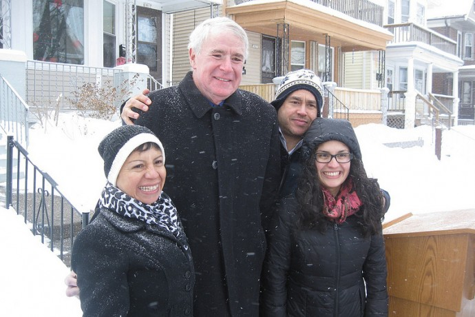 Milwaukee Mayor Tom Barrett shares a laugh with homeowner Marisela Martin, 12th District Alderman José Pérez and another woman after a press conference on the 1800 block of West Arthur Avenue. (Photo by Brendan O'Brien)