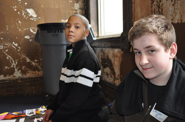 Maurice Williams, a student at Hampton Elementary School and Devon Boyer, a student at Golda Meir School, at Serve2Unite Winter Peace Summit 2014. (Photo by Kayla Parker)