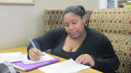 Darneisha Virginia studies in a comfortable corner of the library at Mount Mary University. (Photo by Andrea Waxman)