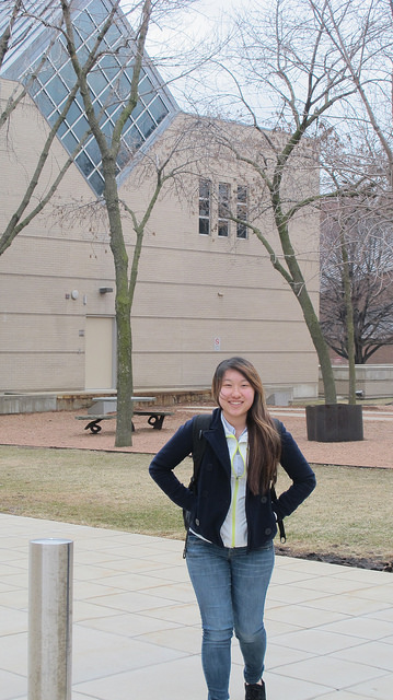 Pa Nou Xiong stands near the Haggerty Museum of Art on the Marquette University campus. (Photo by Andrea Waxman)