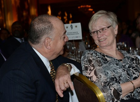 Northwest Side Community Development Corporation Executive Director Howard Snyder and his wife, Janice Wilberg, share a moment after he was chosen as the winner of the Northern Trust Navigator Award at the Pfister Hotel. (Photo by Sue Vliet)