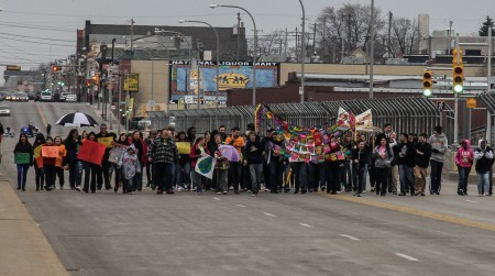 Community members march across the James E. Groppi Unity Bridge as part of a campaign to stop violence in Milwaukee.  (Photo by Karen Slattery)