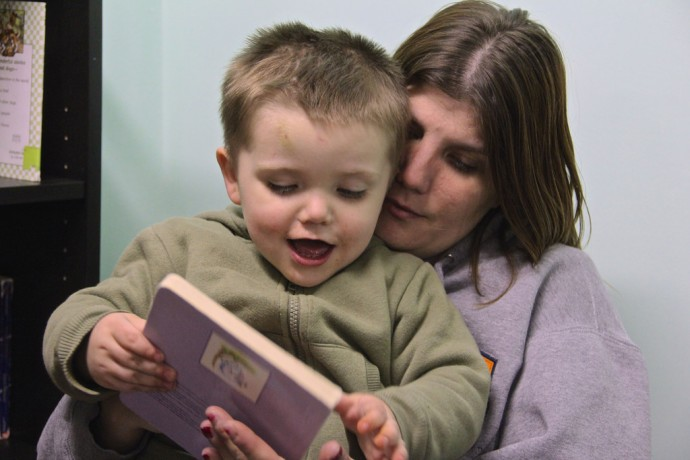 Meta House client Denise and her son, Timothy, were two of more than 20 people on hand for the opening of a new reading room at the facility that treats women for drug and alcohol addiction. (Photo by Karen Slattery)