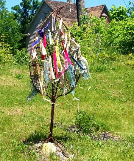 A sculpture in the garden at 33rd and Lisbon becomes a memorial to victims of gun violence. (Photo by Hannah Byron)