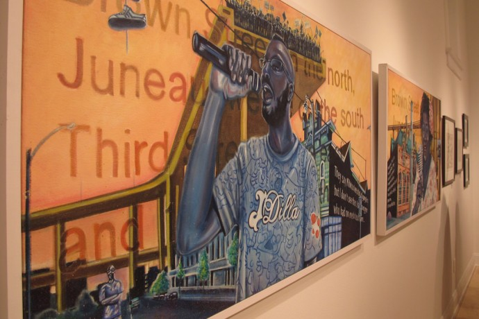 "Two paintings by Mutope J. Johnson are on display at ""The Art of Music in Milwaukee"" exhibit at the Walker's Point Center for the Arts. (Photo by Brittany Carloni)"