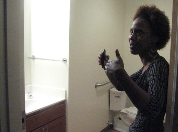 Mercia Harris-Williams shows off her new apartment at Maskani Place. (Photo by Brendan O'Brien)