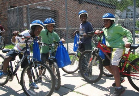Neu-Life youth hop on their new bikes. (Photo by Brittany Carloni)
