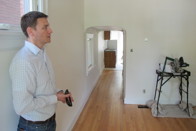 Utopia 136 developer Andrew Lasca leads a tour through an apartment in the firm's new property. (Photo by Patrick Leary)