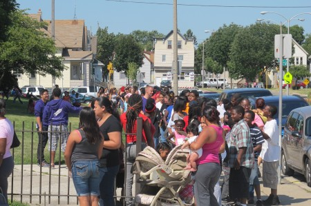 Arrive early. Last year thousands waited in long lines to receive services during the fair at South Division High School, 1515 W. Lapham St. (Photo by Edgar Mendez)
