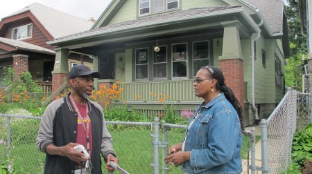 Borchert Field C.A.R.E.S. Secretary Charles Robinson, Sr. and Chair Denise Wooten chat in front of Wooten's house on 14th Street. (Photo by Andrea Waxman)