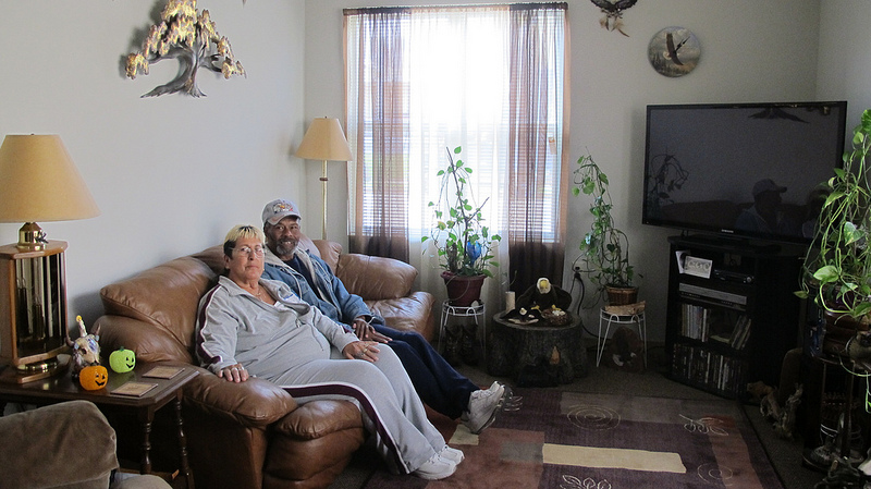 Jill and Charlie Harris relax in their rental townhome at King Commons IV. (Photo by Scottie Lee Meyers)