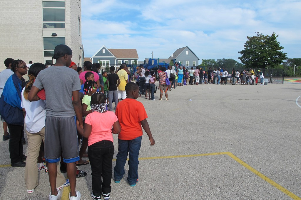 Hundreds of people lined up for a backpack giveaway at Silver Spring Neighborhood Center. (Photo by Edgar Mendez)