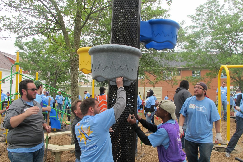 Volunteers build a piece of playground equipment in Harambee. (Photo By Raina J. Johnson)