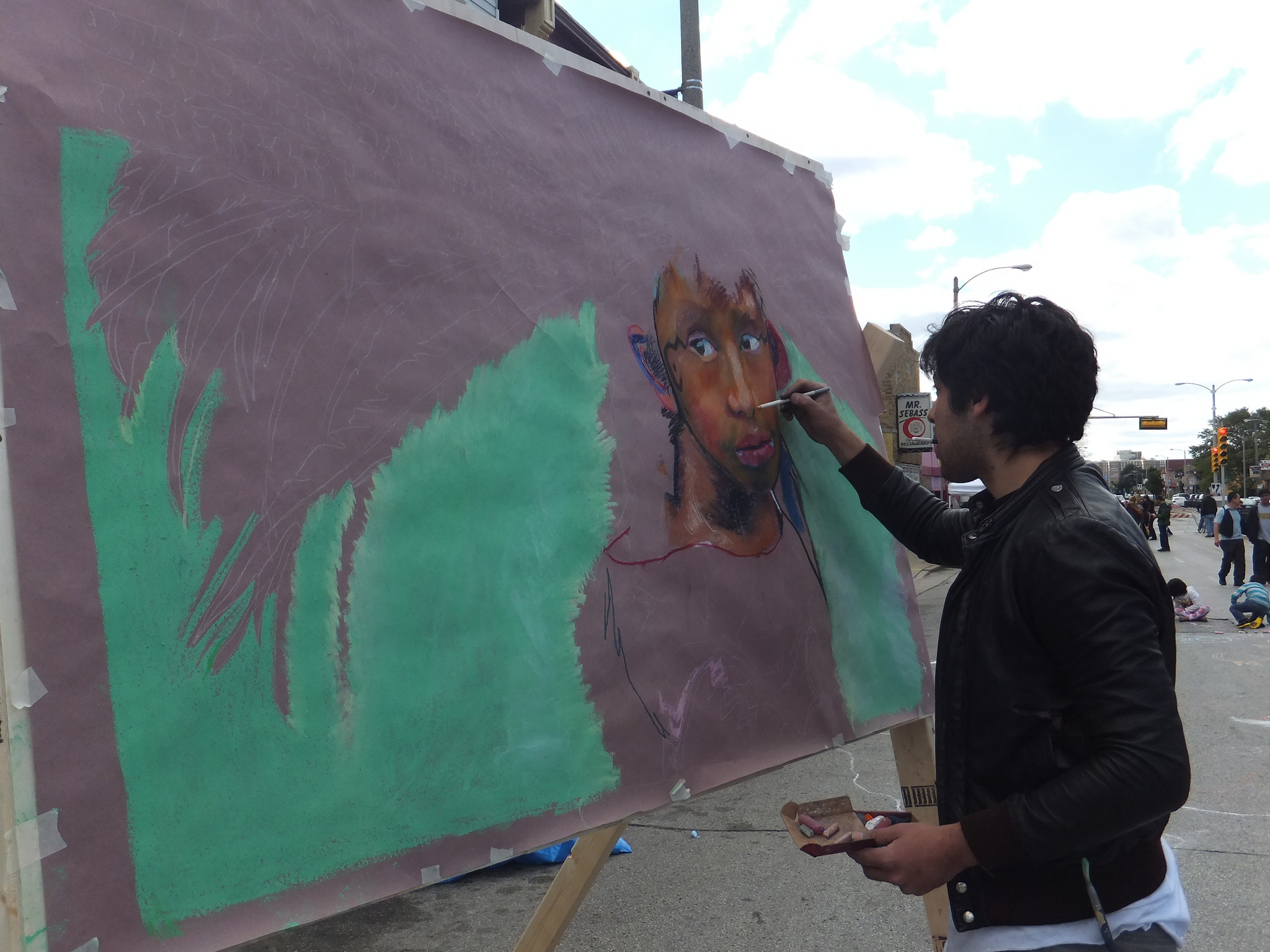 Artist Sydney Romero paints a portrait at the 3rd Annual Silver City International Food & Art Walk. (Photo by Teran Powell)