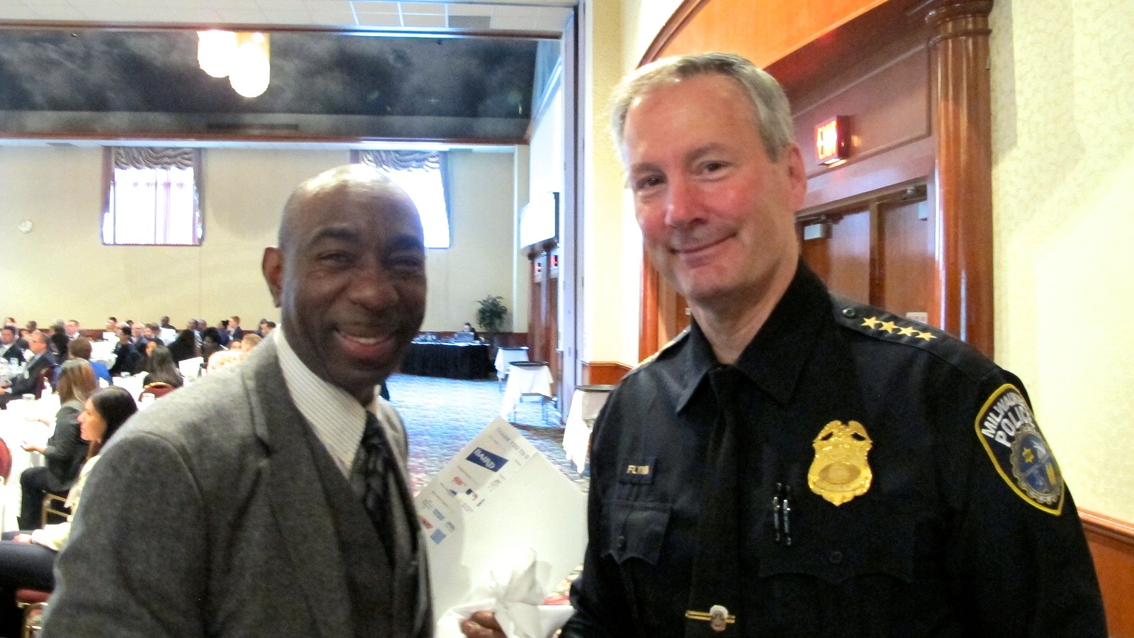 Charles Robinson with Milwaukee Police Chief Edward Flynn this week at the Safe & Sound Annual Awards Breakfast at the Italian Community Center. (Photo by Andrea Waxman)