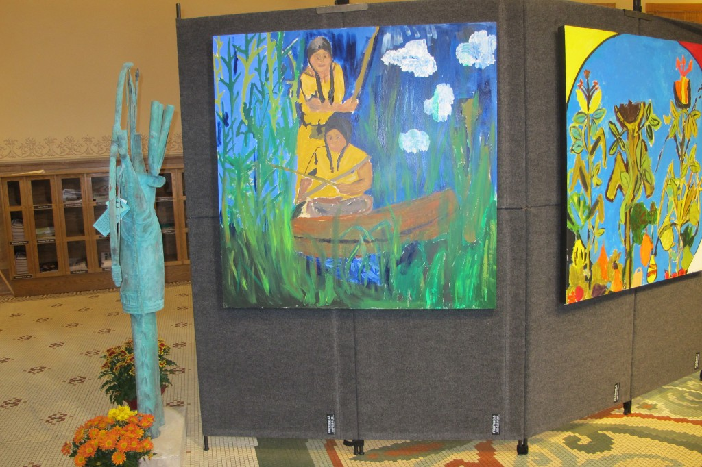 The vibrant paintings on display at City Hall were created by youth at the Urban Ecology Center in Menomonee Valley this summer. (Photo by Raina J. Johnson)