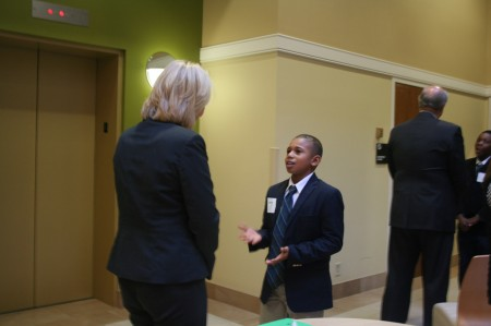 Montavion Pewitt, 11, engages one of The Great Handshake judges. (Photo by Jabril Faraj)