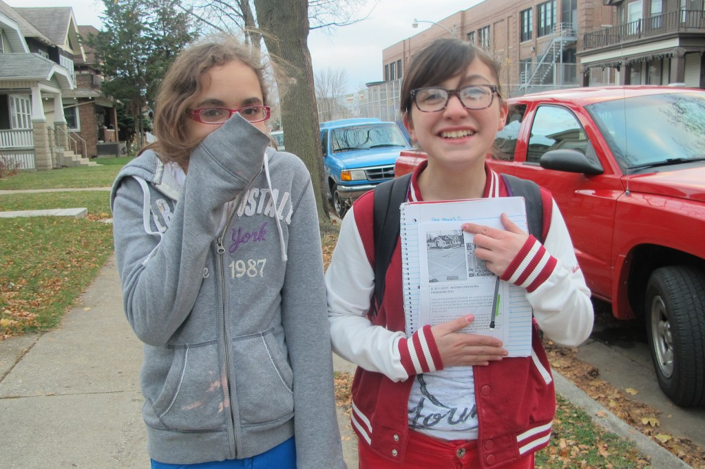 Yahaira Cruz, 12 (left) and Anna Morales, 13, went together to distribute fliers about their public art project.
