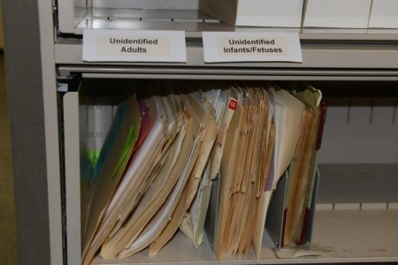 A file cabinet contains case files of the unclaimed and unidentified bodies.. (Photo by Sue Vliet)