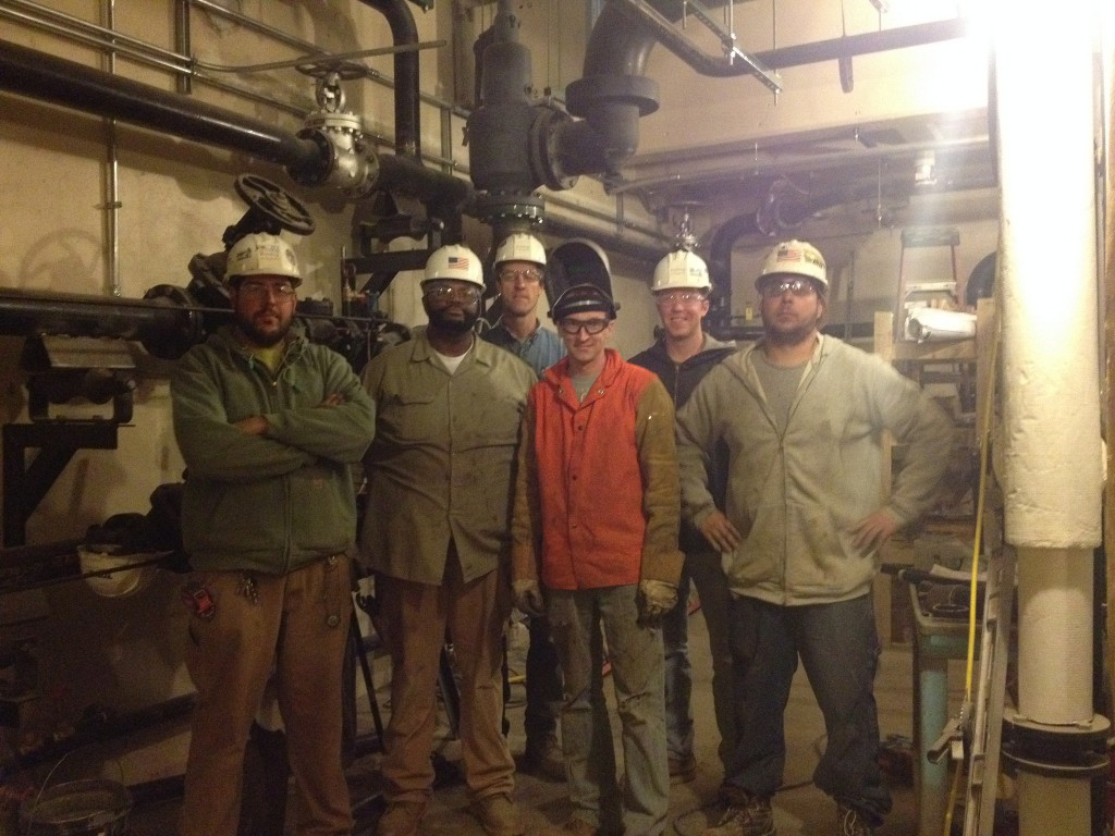 Quinn Palmer (third from left, in back) and his crew work on a steam conversion sterilization room at Clement J. Zablocki VA Medical Center. (Photo courtesy of Quinn Palmer)