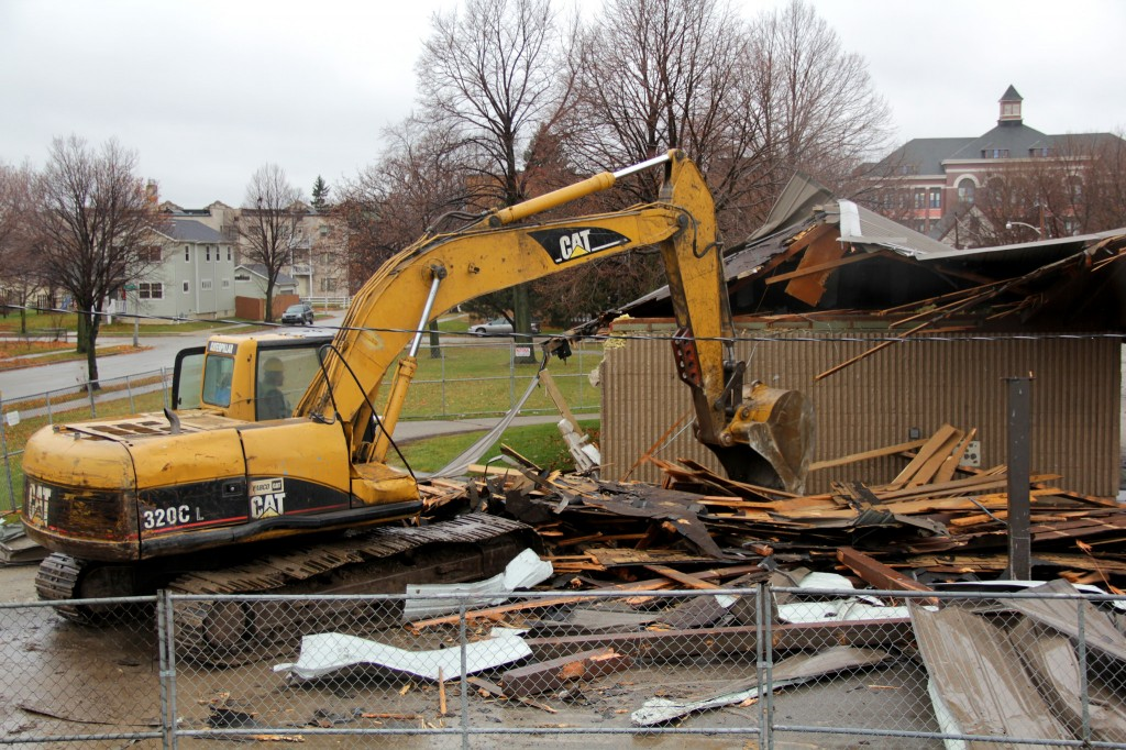 A backhoe driver demolishes the Johnsons Park pavilion to make way for a new restroom building and other improvements next spring and summer. (Photo by Molly Rippinger)