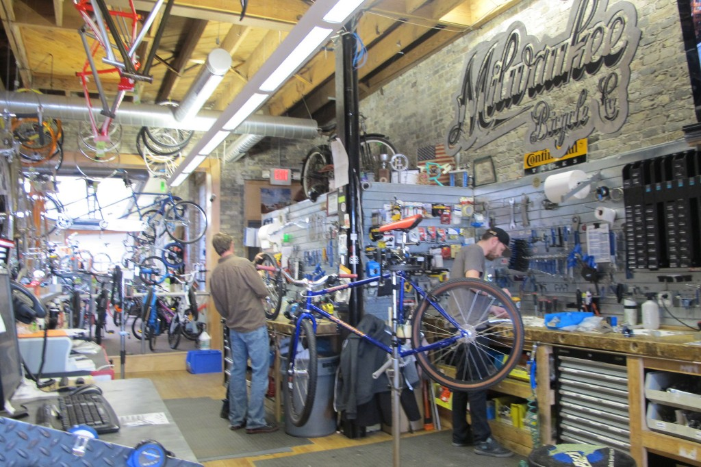 Employees at Milwaukee Bicycle Company fix bicycles for customers. (Photo by Raina J. Johnson)