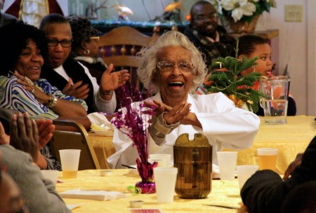 Annie Naomi Scott enjoys a round of applause during a dinner that celebrated her winning a soup kitchen makeover. (Photo by Molly Rippinger)