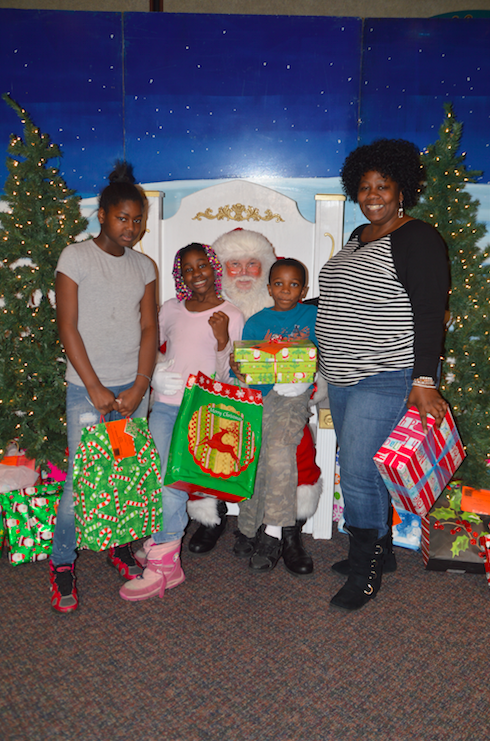 "Assurant Health hosted ""Lunch with Santa"" for the children and moms of Joy House"