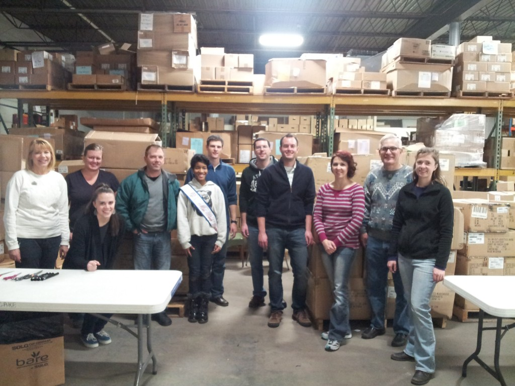 Volunteers from MPS' Washington High School of Information Technology and Koss Corporation help with the sorting and processing of donations before items head to schools