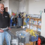Ondra Stovall, CleanTec lead man since 2009, prepares to take cleaning equipment from the company's storage room to a commercial client's site. (Photo by Andrea Waxman)