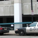Squad cars are parked outside of the City of Milwaukee Police Administration building. (Photo by Brendan O'Brien)
