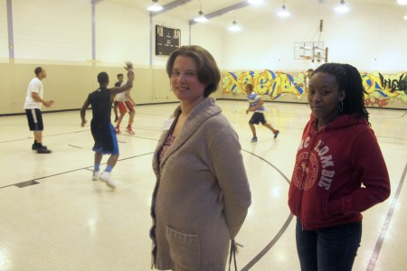 Anna Bierer, director of programming at Neighborhood House, and Maya McCullough hang out during a pick-up game. (Photo by Edgar Mendez)