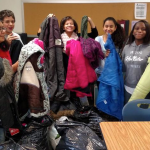 Seventh graders at Golda Meir Gifted and Talented School worked on a coat drive as part of a service-learning project. (Photo by Robyn St. John)